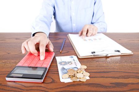 Calculating income businessman Stock Photo