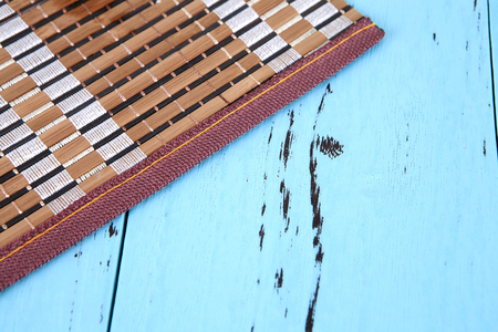 Bamboo mat on blue background