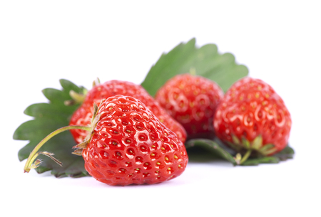 collocation: Red strawberries and green leaves Stock Photo
