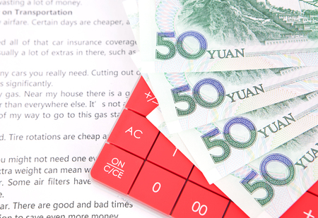 Calculator in English and Chinese currency Stock Photo