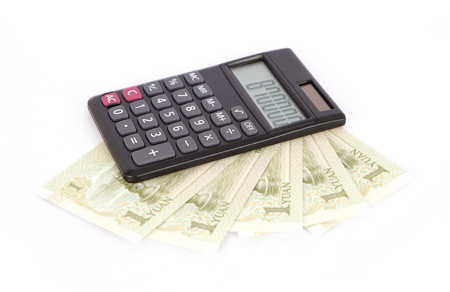 property management: Calculator and paper money Stock Photo