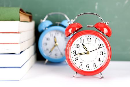 Books and alarm clocks Stock Photo