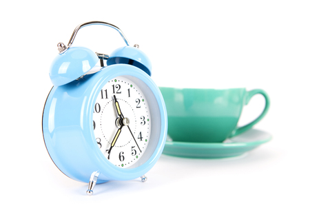 Blue alarm clock and a cup of coffee