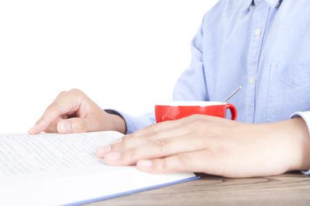 gloss: An adult man reading a Book