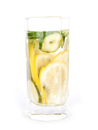 A cup of lemon cucumber water on a white background