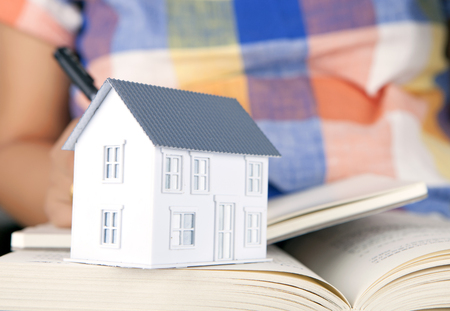 Readers house model on books Stock Photo