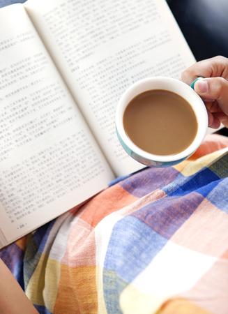 reader having coffee