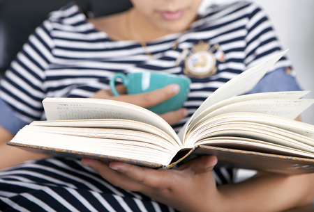 Close up view of a woman hand holding a book Stock Photo