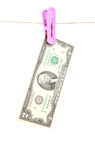 Dollar note hanging on a thread