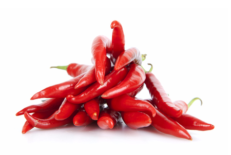 A pile of red peppers in the white background