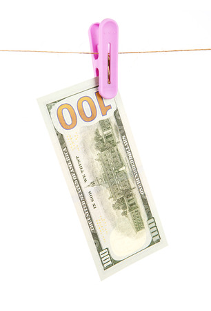 A dollar bill hanging on a thread on white background Stock Photo