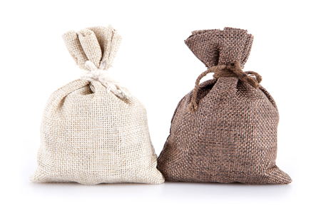 Sacks of money on white background
