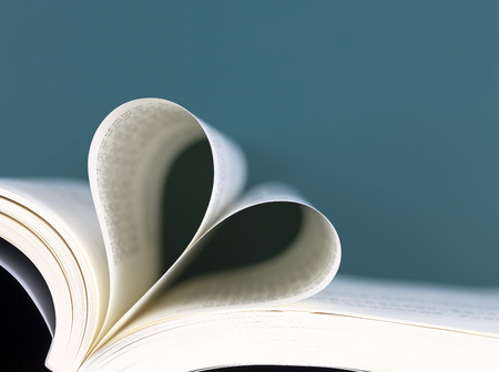 pages of book folded into heart shape Stock Photo