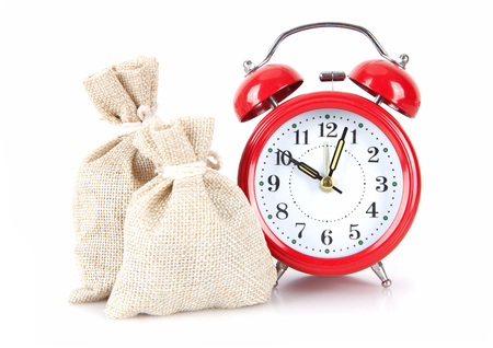 Alarm clock and two sack background on white background Stock Photo