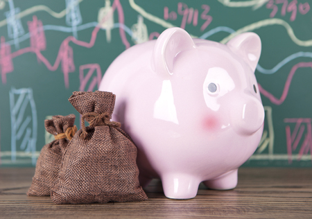 Saving concept with a pink piggy bank
