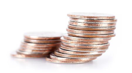 Dollar coin stacks on white background Stock Photo