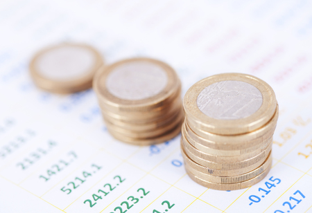 Euro coins in financial figures Stock Photo
