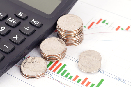 Financial investment plan with coins and calculator Stock Photo