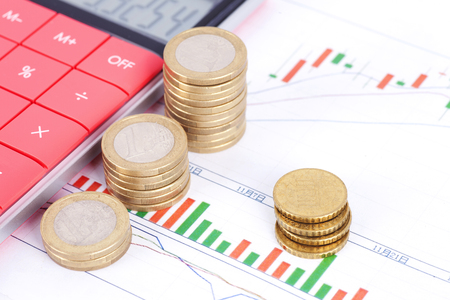 Financial investments concept with coin stacks and calculator