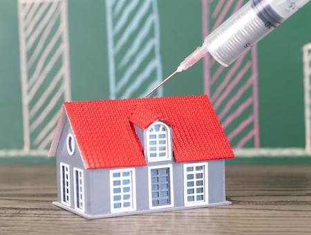 Real estate concept with a house model Banco de Imagens