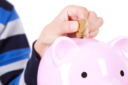 savings concept with a piggy bank on white background Stock Photo