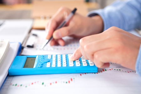 Financial investments concept with a calculator