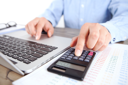 Accountant using a calculator close up view 스톡 콘텐츠