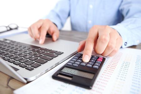 Accountant using a calculator close up view Standard-Bild