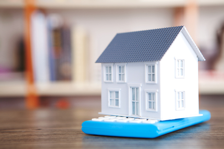 A house model on a calculator Stock Photo