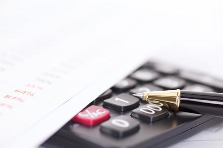 A pen on a calculator