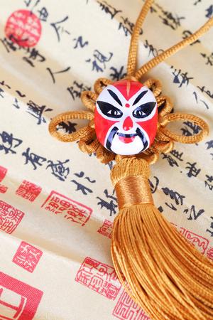 Opera masks and calligraphy fan