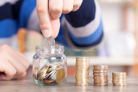 Investment and Financing with coin stacks on the table