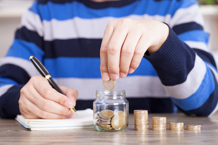 Investor concept with coin stacks on the table Stock Photo