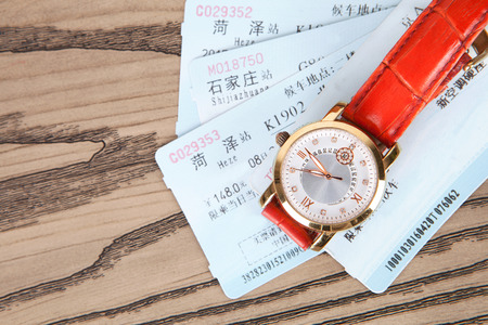 Train tickets and watches on the table