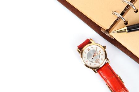 Notebook and watch on white background Standard-Bild