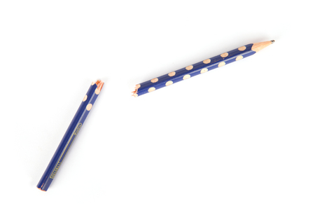 A broken pencil on white background