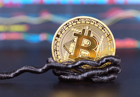 A bit of bitcoin tied to a rope 版權商用圖片 - 96670495