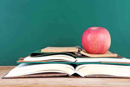 Open the red apple on the book Stock Photo