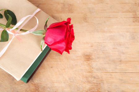 Red roses on books