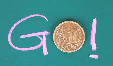 The go of chalk words and coins Foto de archivo