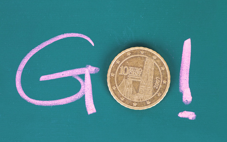 The go of chalk words and coins Imagens