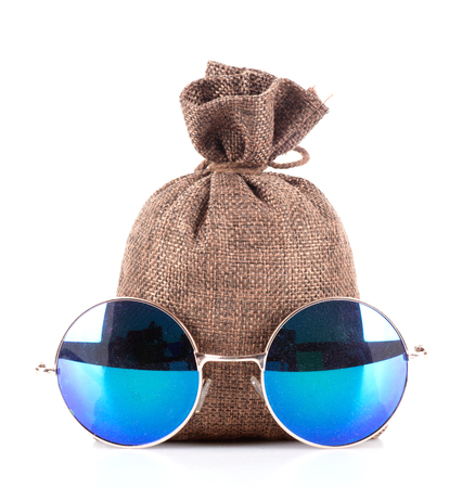money bag and sunglasses