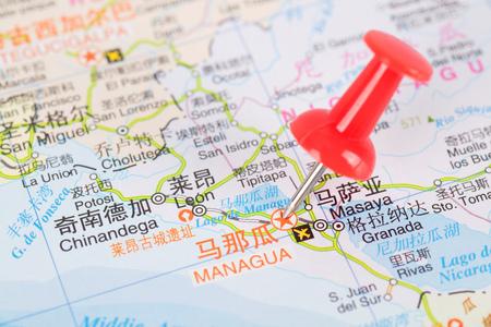 red push pin marking managua, nicaragua  for next travel Plan