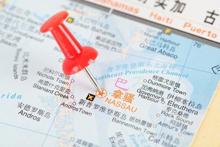 red push pin marking Nassau, capital of the Bahamas  for next travel Plan Editorial