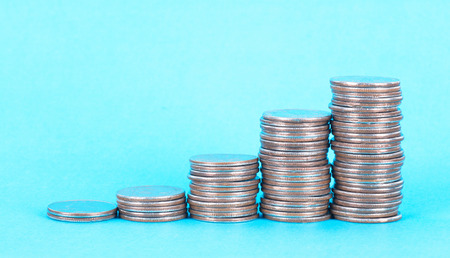 Dollar coin on blue background Stock Photo