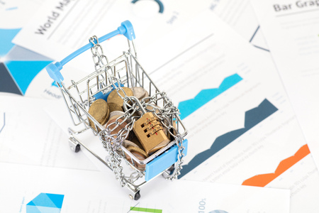 Locked shopping cart and coins inside