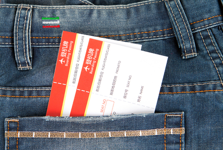 Boarding pass in jeans pocket Stock Photo