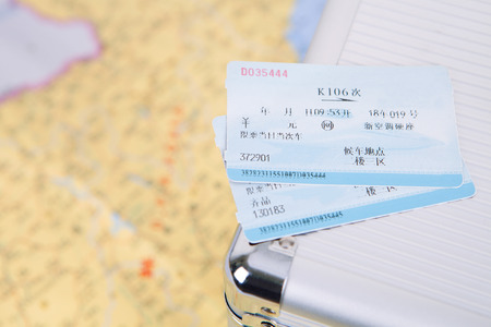 Train ticket on the suitcase
