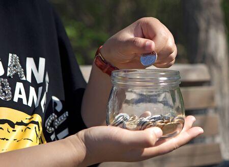 Savings concept, Save money at glass jar Imagens