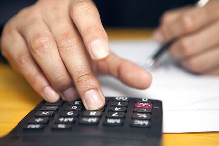Accountant using calculator Imagens